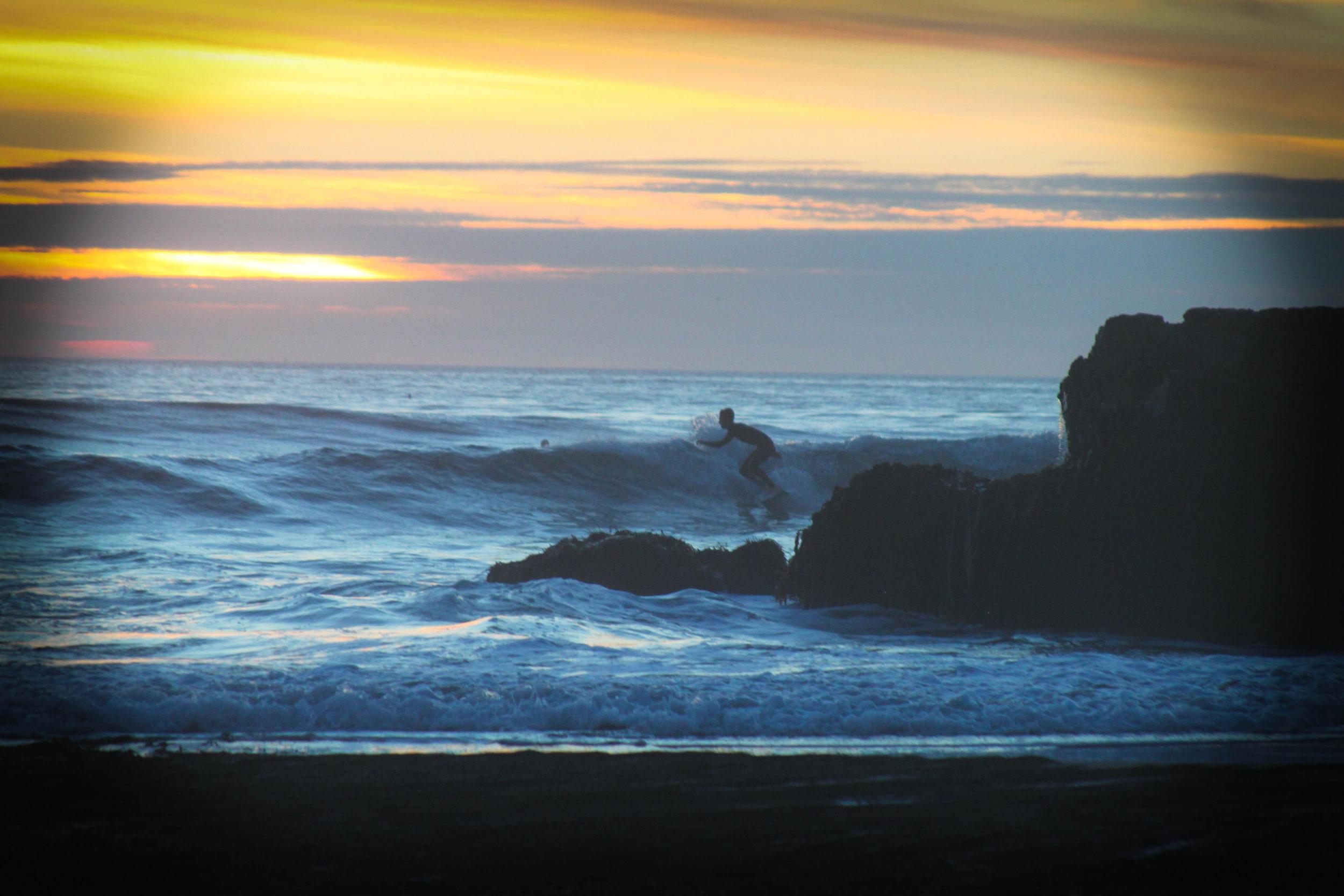 low tide surfer
