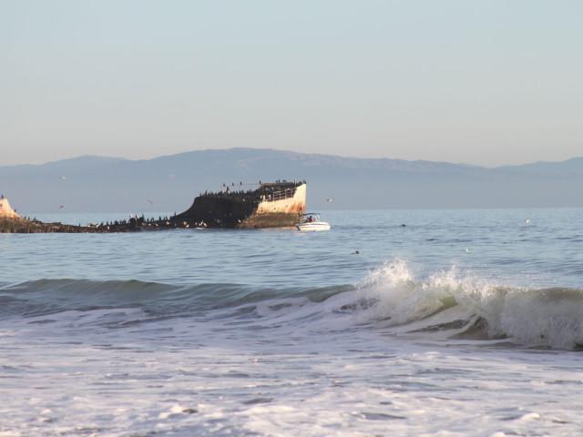 Small boat visits the Cement Ship